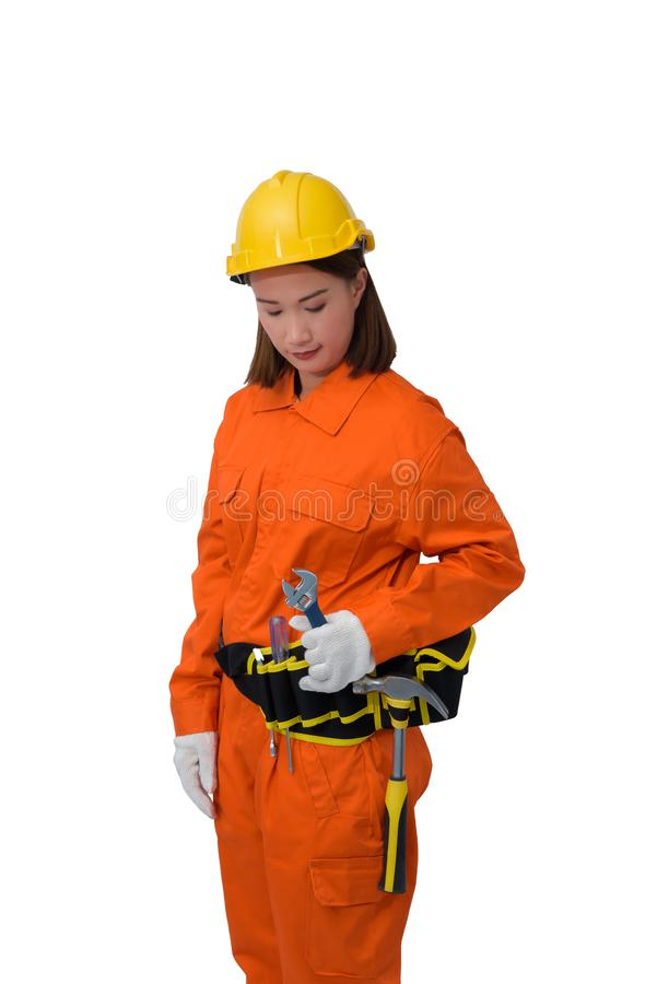 Construction workers wearing Orange Protective clothes, helmet hand holding wrench with tool belt isolated on white backround. Construction woman workers wearing stock image