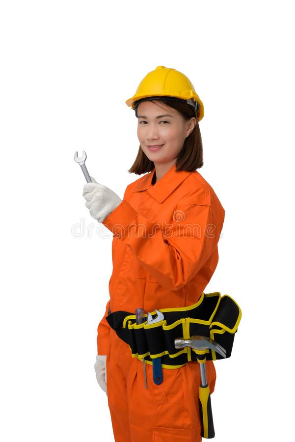 Construction workers wearing Orange Protective clothes, helmet hand holding wrench with tool belt isolated on white backround. Construction woman workers wearing royalty free stock photography