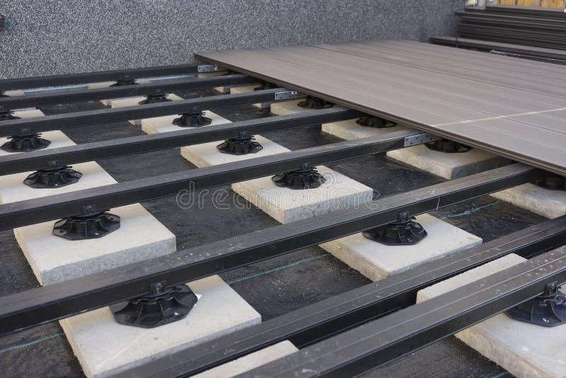 Construction of a wood-plastic composite garden terrace. Construction of a wood plastic composite garden terrace stock photos