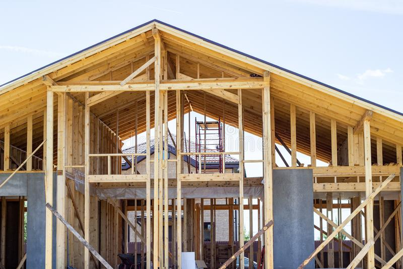 Construction of a wooden house. Beam. Blue Sky. Architecture. stock photo