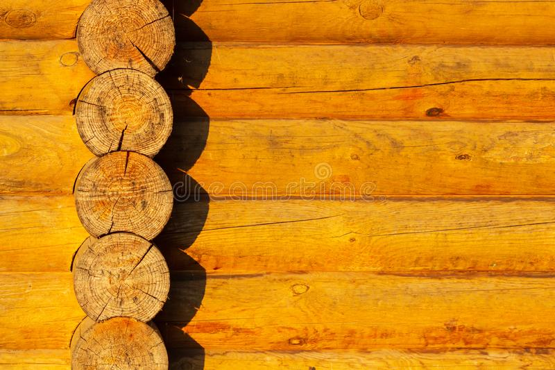 Construction of the wooden house from round logs. Blockhouse logs close up. stock images