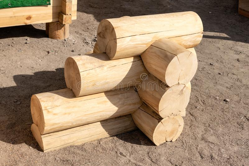 Construction of the wooden house from round logs. Blockhouse logs example, element in store. Corner connection of wooden log house royalty free stock photo