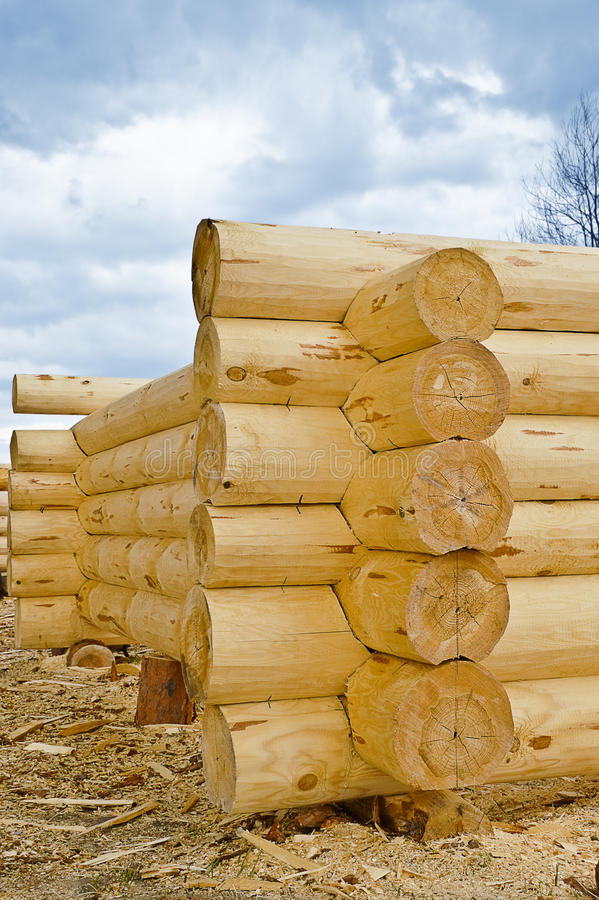 Construction of wooden houses. Construction of a wooden house - corner log royalty free stock images