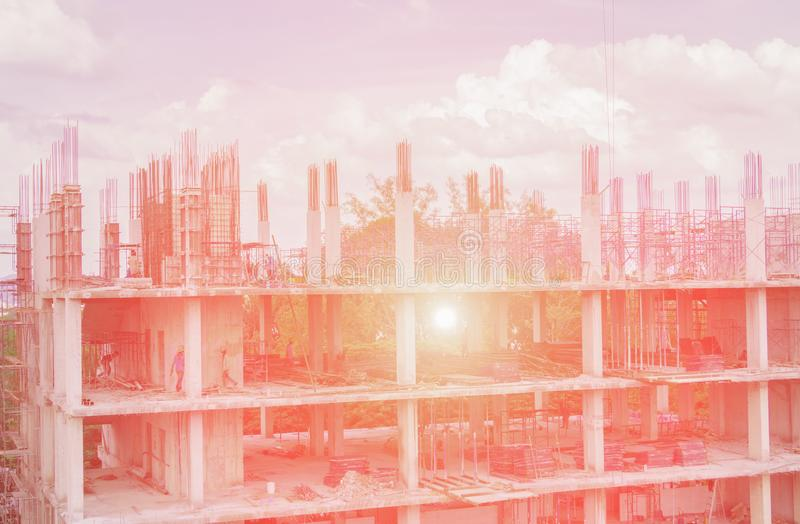 Construction work in building site workplace with worker and sunrise light with copy space add text.  stock image