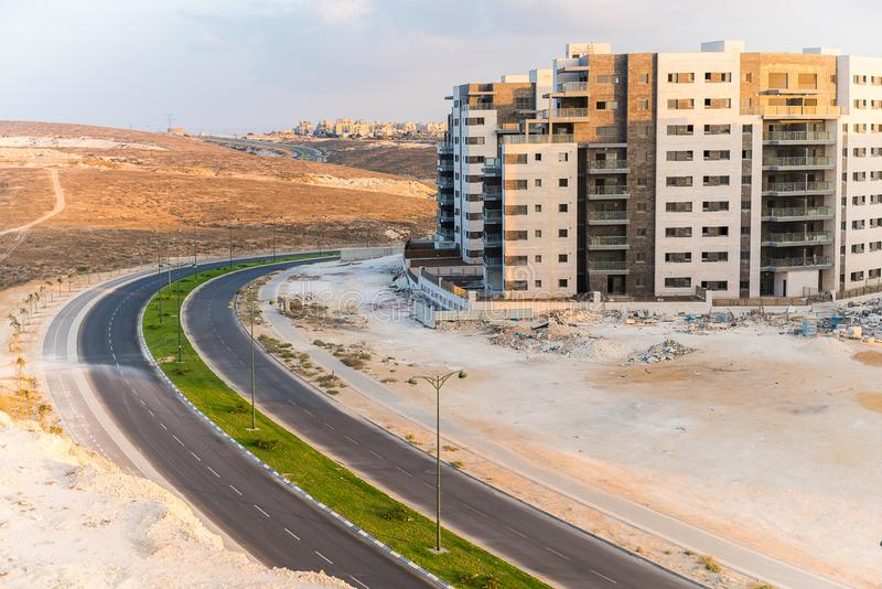 New building and a road. Construction work in the desert, new building and a road stock image
