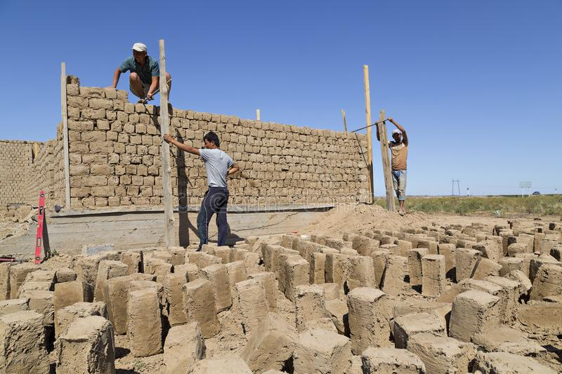 Construction work with mud bricks in Shymkent, Kazakhstan. royalty free stock photo