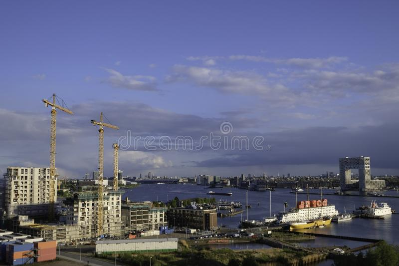 Construction work North Amsterdam with view on river IJ stock photography