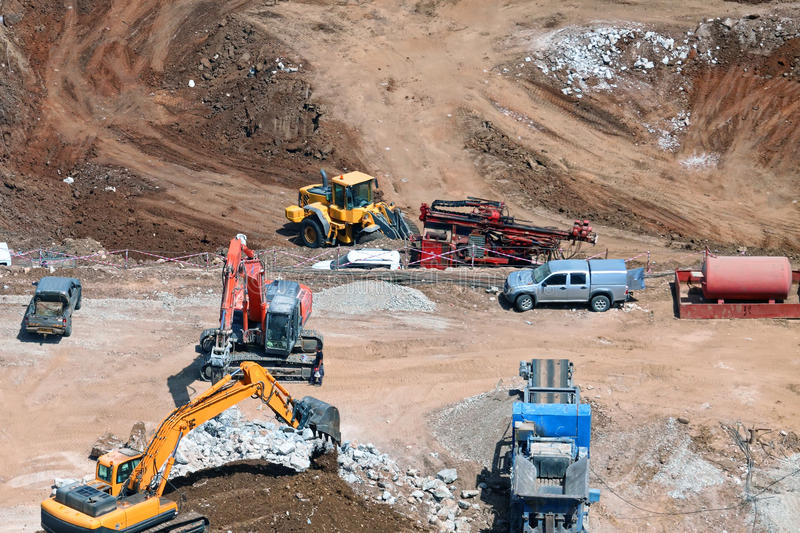Construction work site. Bird view of construction work site with construction machinery royalty free stock images