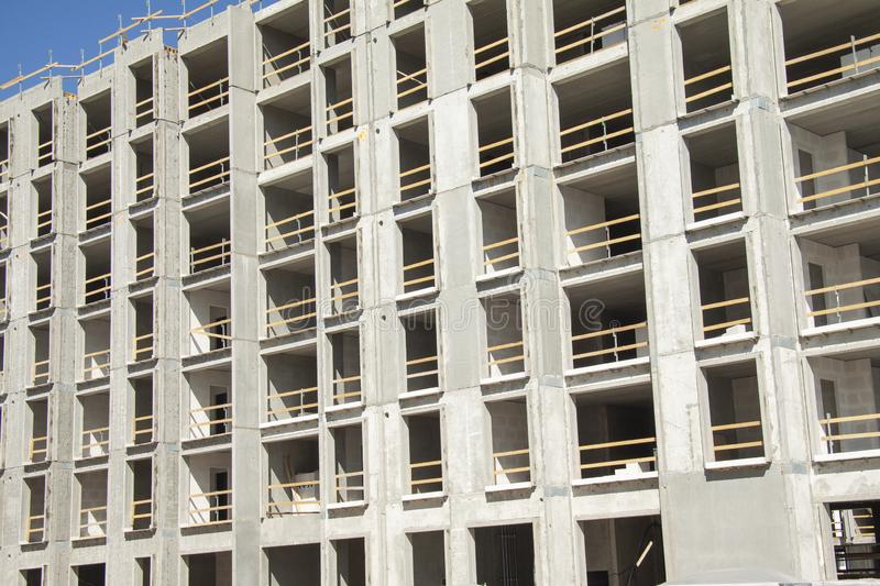 Construction work site of a multi-storey building showing frames of naked concrete walls with empty spaces. Contruction workes pro royalty free stock photos