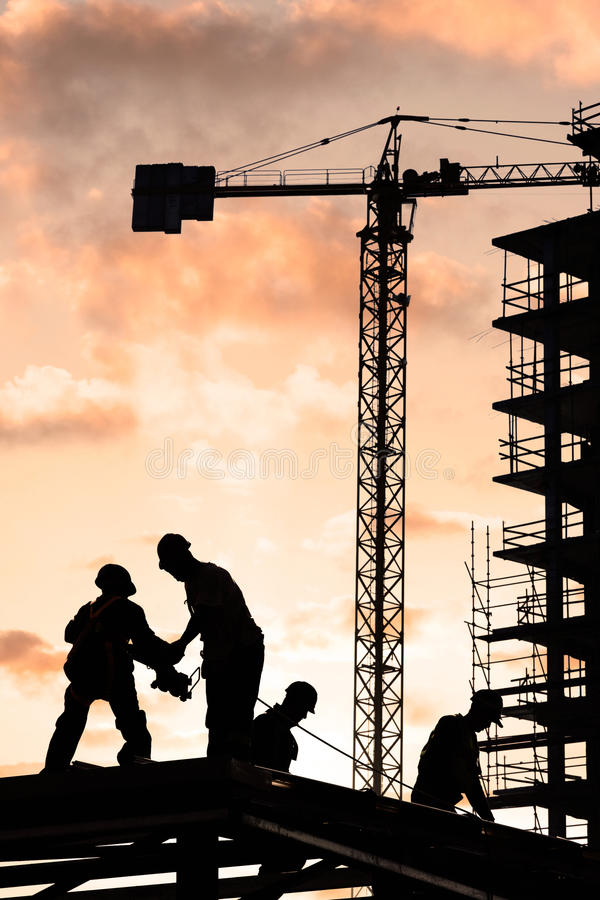 Construction worker. Silhouette of construction worker at sunset royalty free stock image
