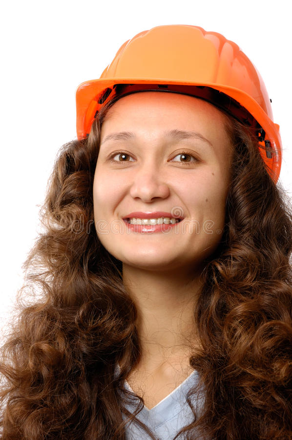 Construction Worker. Portrait of a young woman in a hard hat isolated on white background. Construction worker or intern concept stock photos