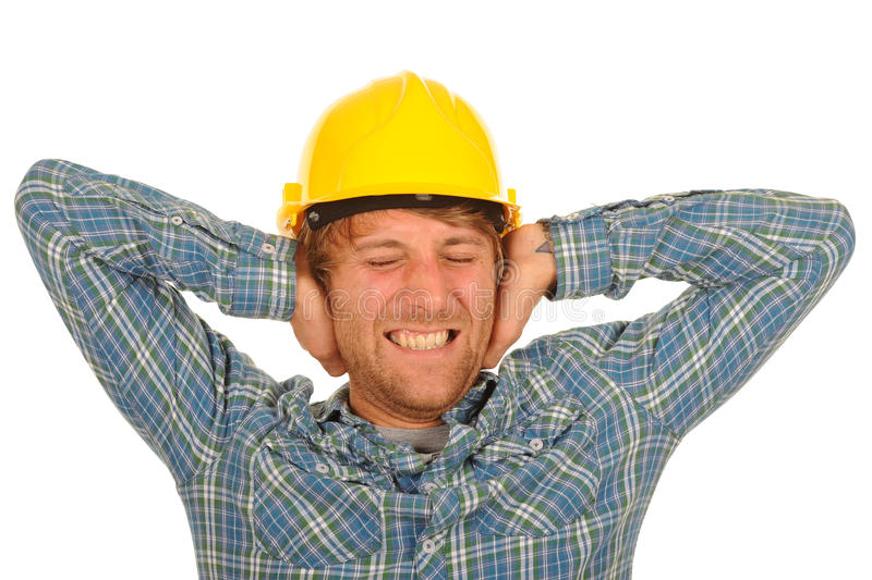 Construction worker. Male construction worker holding his hands over his ears stock photos