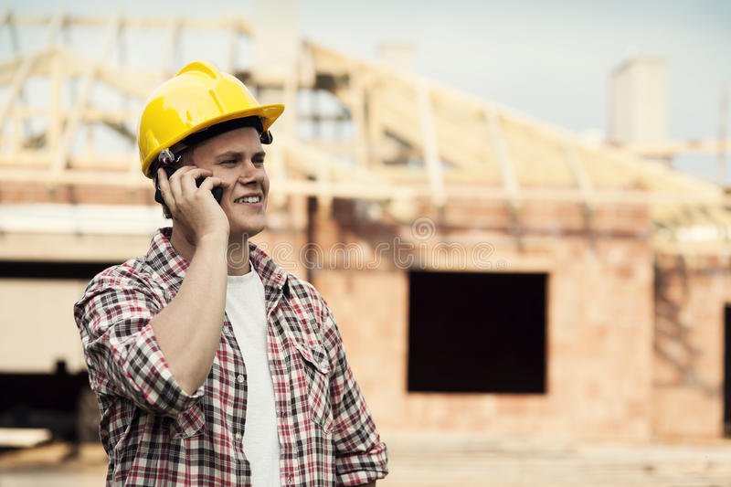 Construction worker. Tools & Construction collection: Construction worker with mobile phone stock images