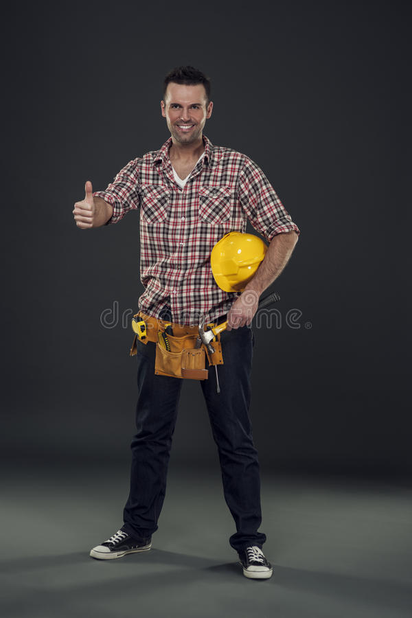 Construction worker. Showing thumbs up stock photo