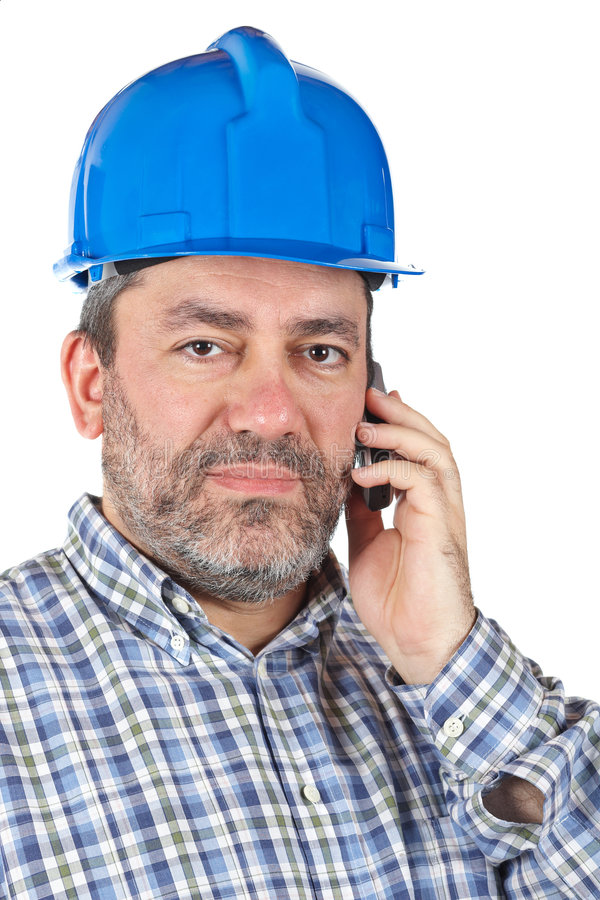 Construction worker. With hardhat talking with phone isolated on a white background stock photography