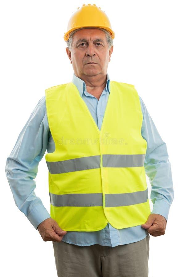 Construction worker arranging vest stock image