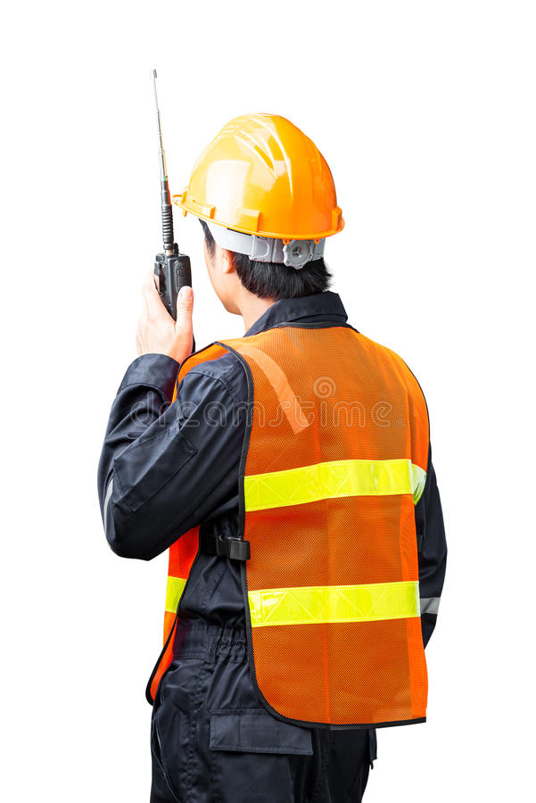 Construction worker. Backside of construction worker command speaking from portable radio isolated on white royalty free stock image