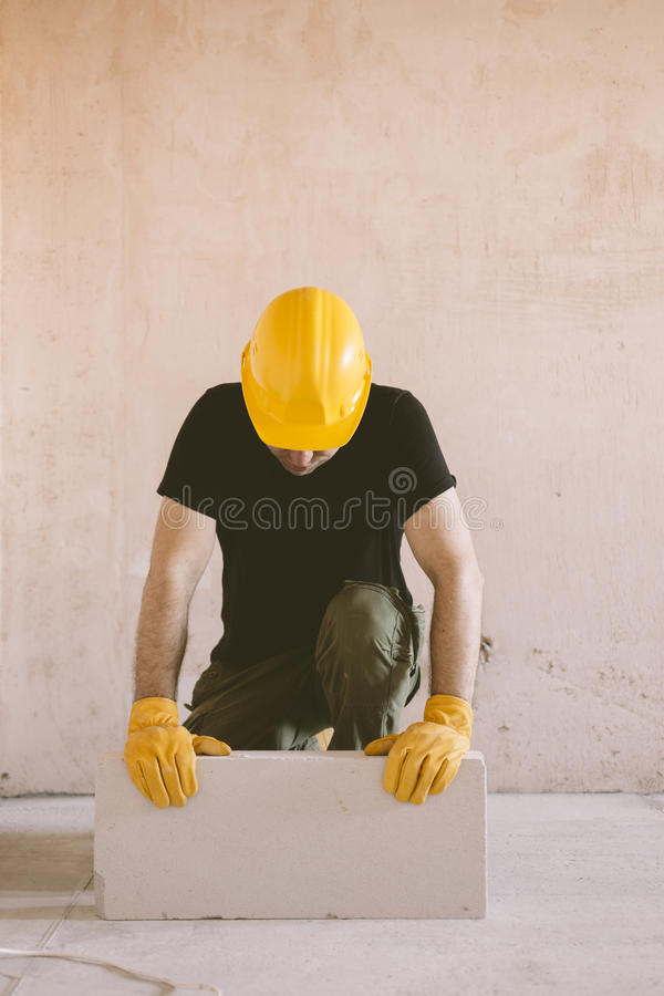Construction worker with block stock photo