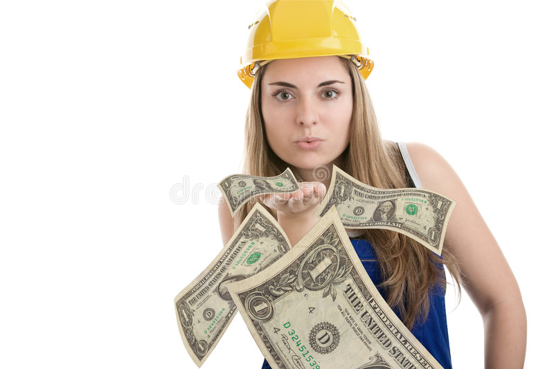 Construction worker blowing money stock images