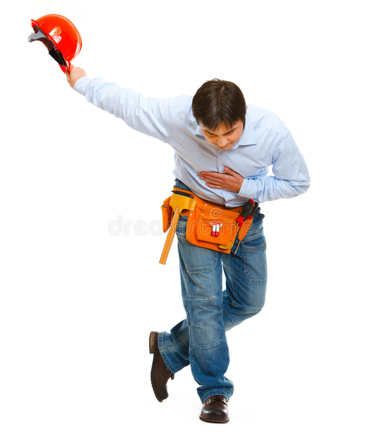 Construction worker bowing with helmet in hand stock image
