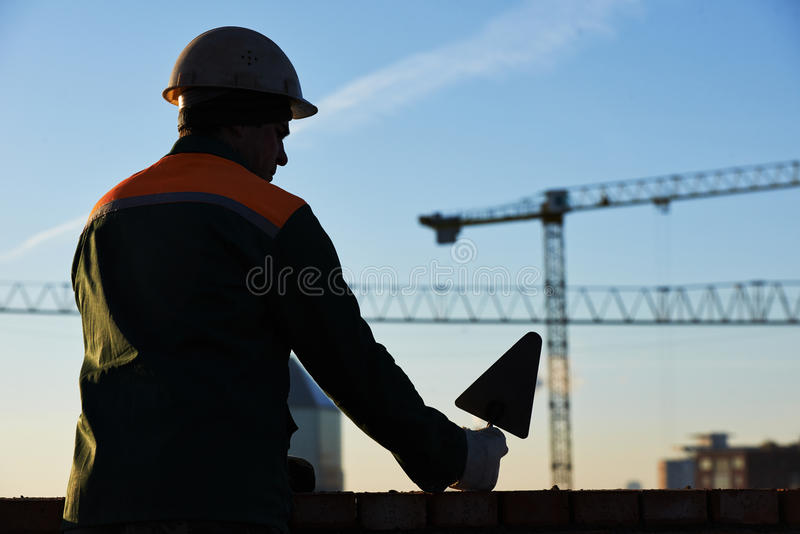 Construction worker bricklayer. Silhouette royalty free stock photos