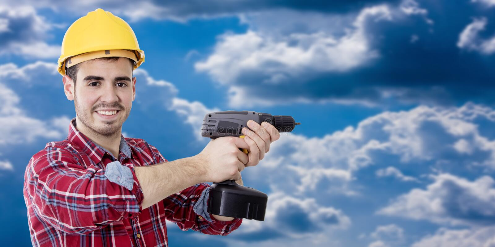 Construction worker and bricolage. With drill and space for text stock image