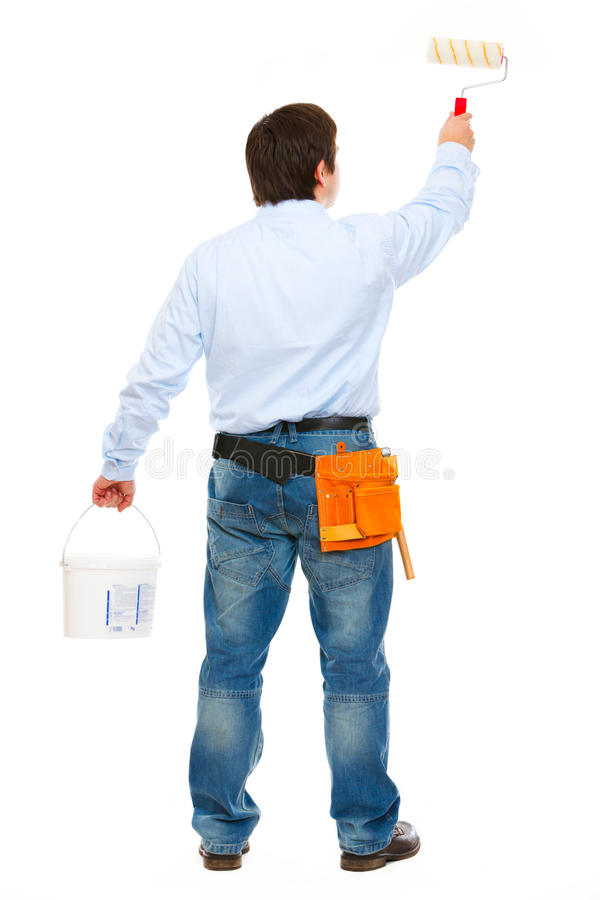 Construction worker with bucket and brush painting royalty free stock image