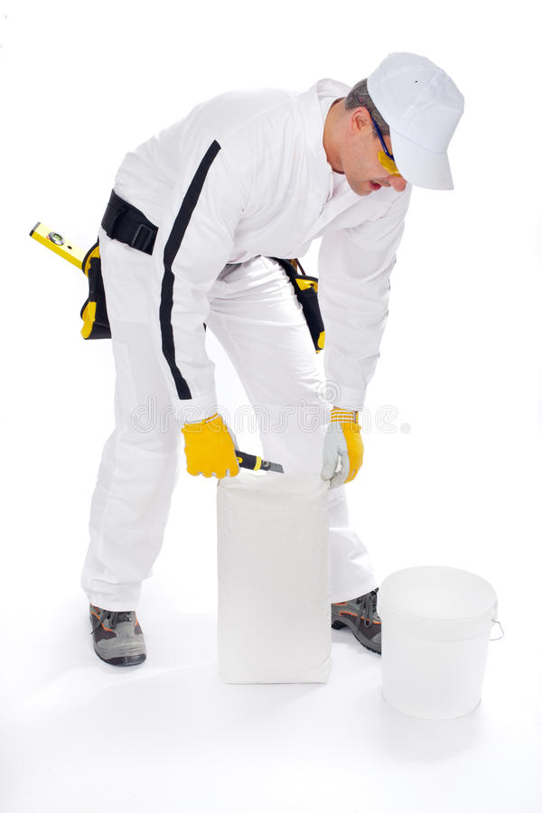 Construction worker with bucket and tile adhesive royalty free stock photos
