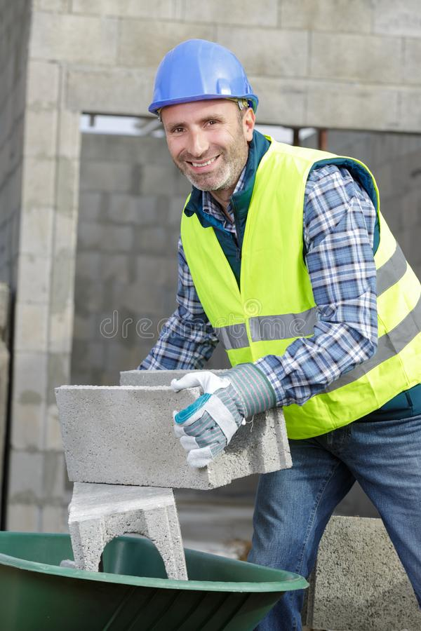 Construction worker on building industry construction site royalty free stock photos