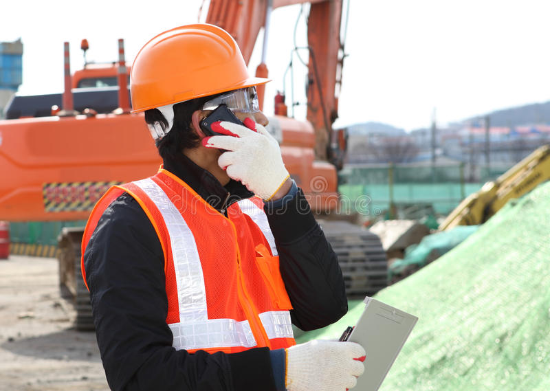 Download Construction Worker With Building Plans And Cellphone Stock Image - Image: 29552441