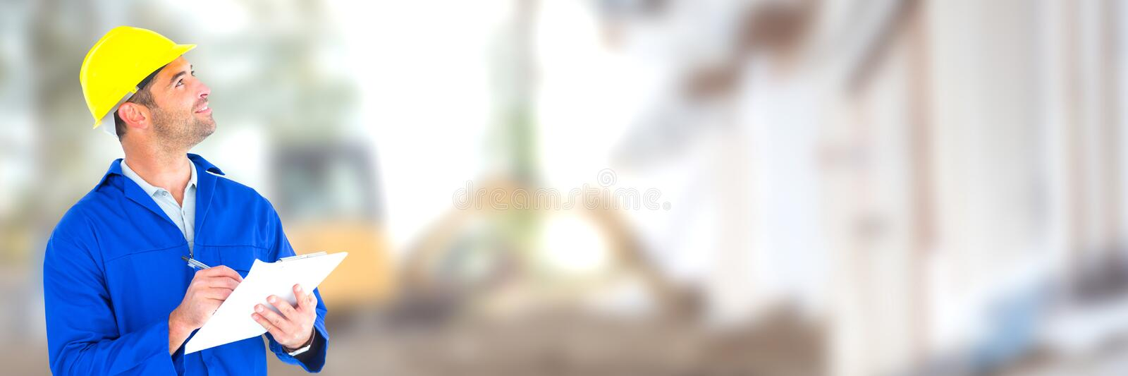 Construction Worker on building site with chart plans royalty free stock photos