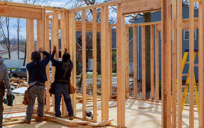 Construction Worker Building Timber Frame In New Home royalty free stock image