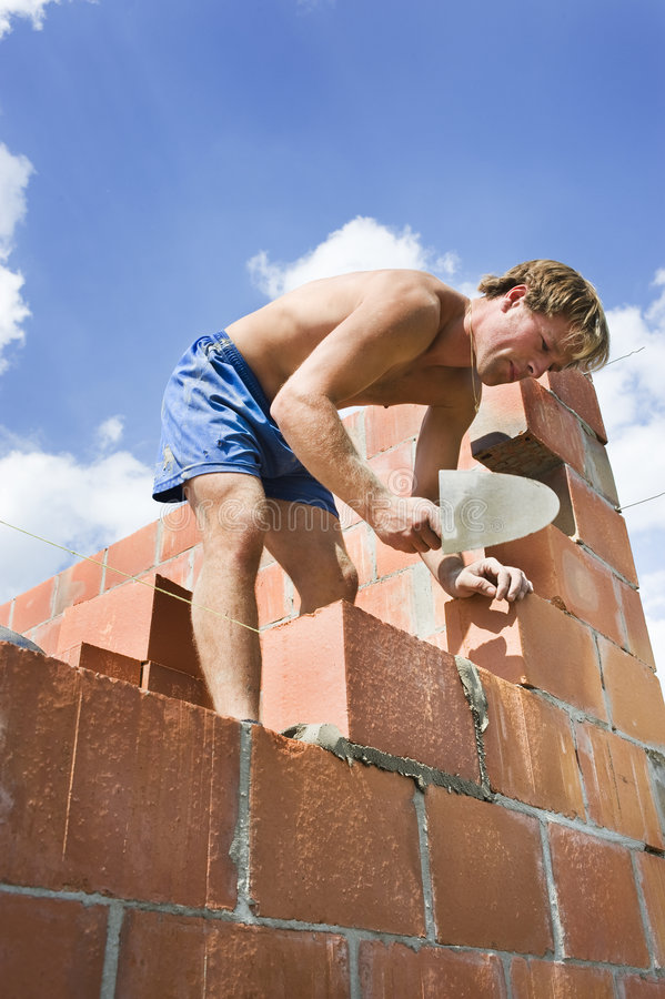 Construction worker building a wall stock photography