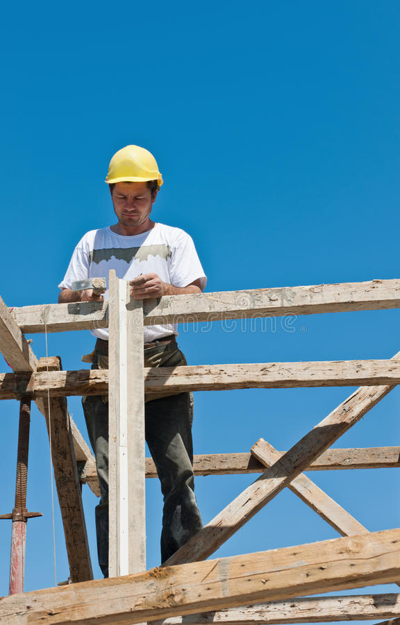 Construction worker busy on formwork preparation stock photography
