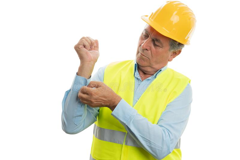 Construction worker buttoning sleeve stock images