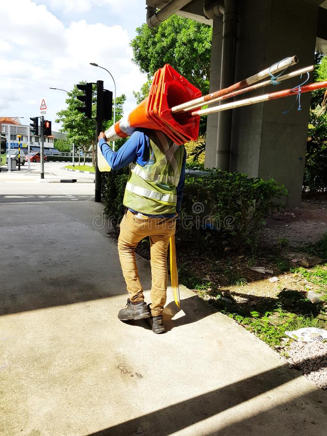 Construction worker carrying construction materials royalty free stock images