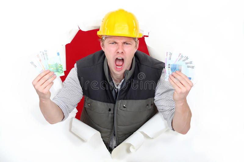 Construction worker with cash. royalty free stock image