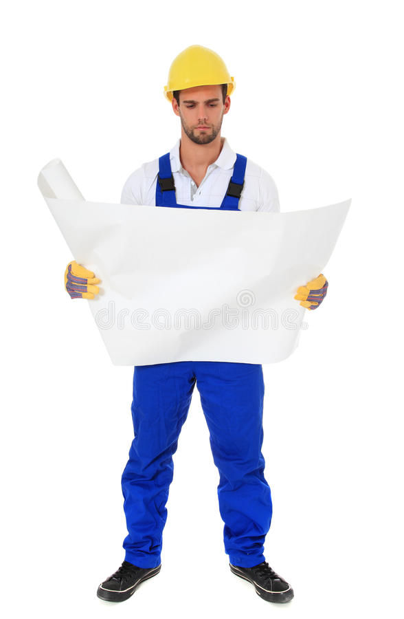 Construction worker checking blueprint royalty free stock images