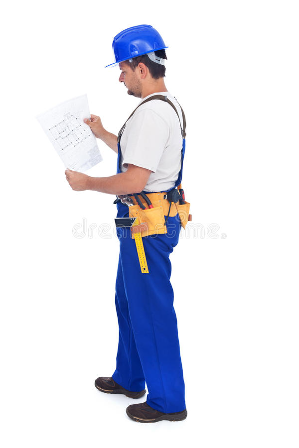 Construction Worker Checking The Blueprints Stock Photography