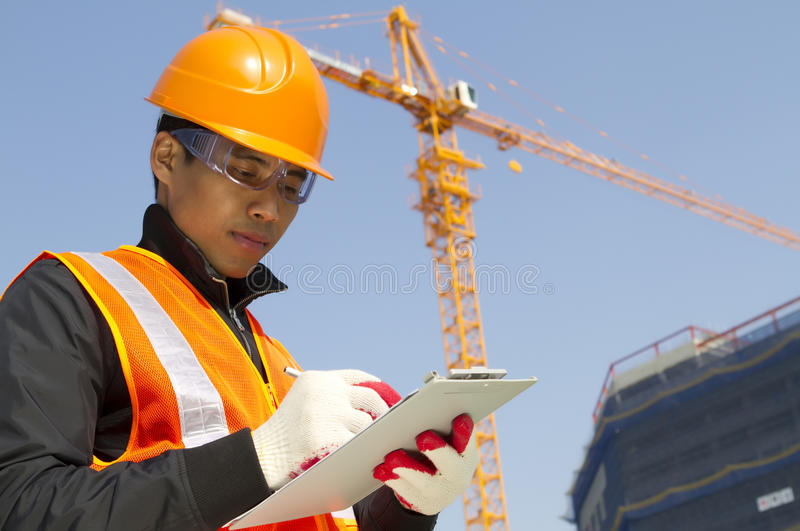 Download Construction Worker With Crane In Background Stock Image - Image: 30253439
