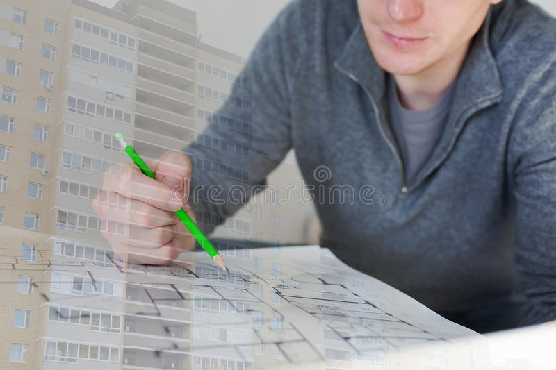 A construction worker checking documents and a new residential building collage. A construction worker checking documents with pencil in his hand and a new royalty free stock photo
