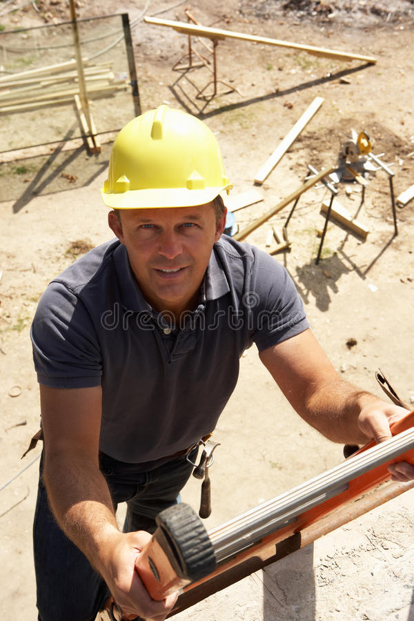 Construction Worker Climbing Ladder stock images