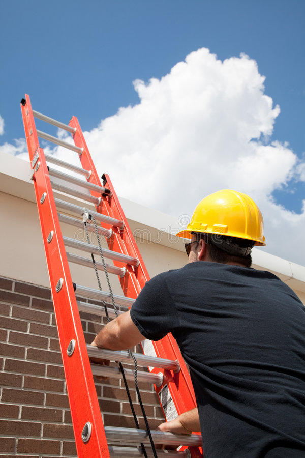 Construction Worker Climbs Ladder stock photo