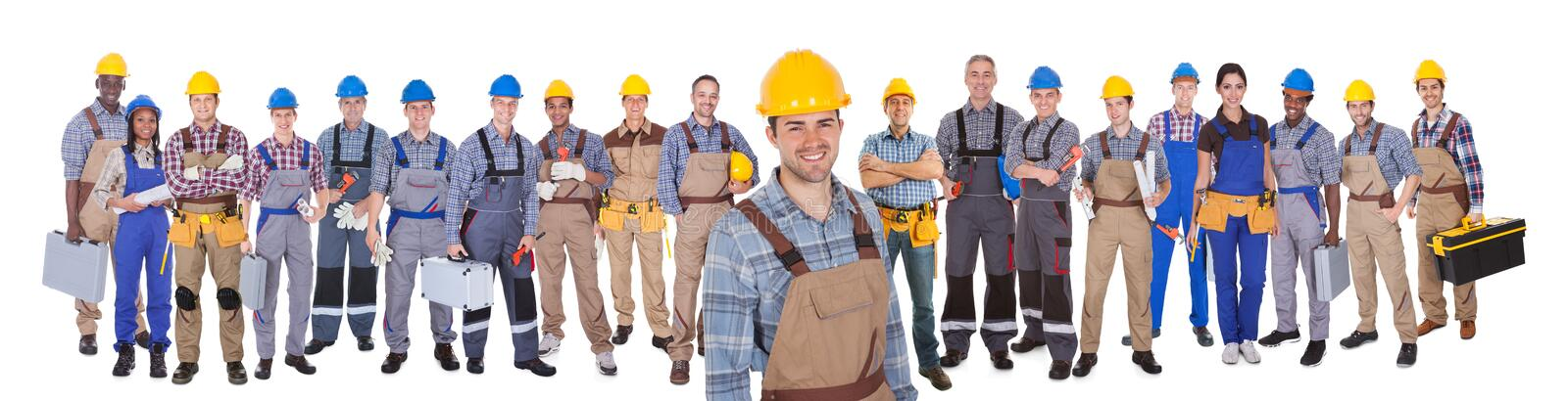 Construction worker with colleagues over white background. Portrait of happy construction worker with colleagues standing over white background royalty free stock photos