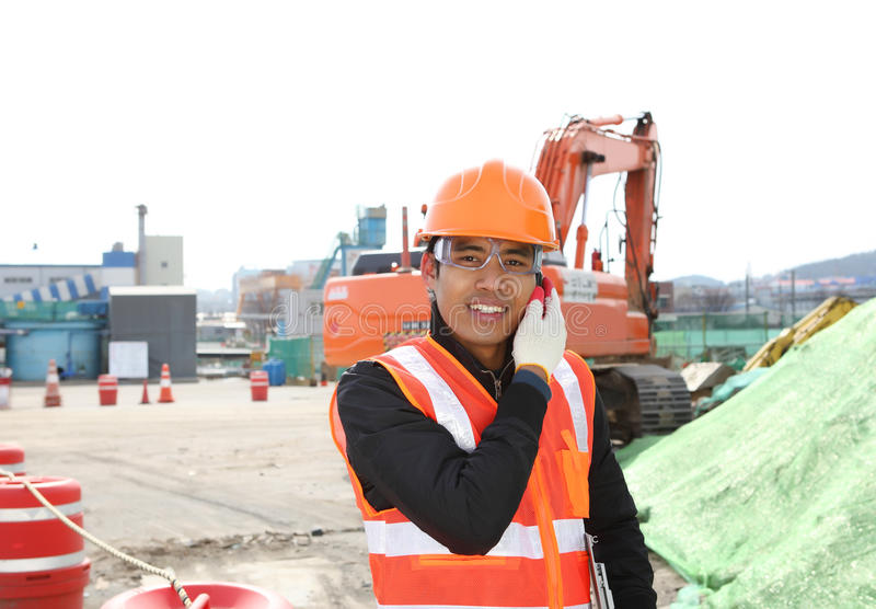 Download Construction Worker Communication With Mobile Phone Stock Photo - Image: 29552402