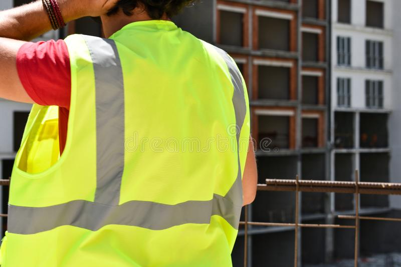 Construction worker, construction manufacture background. Workers stock photos