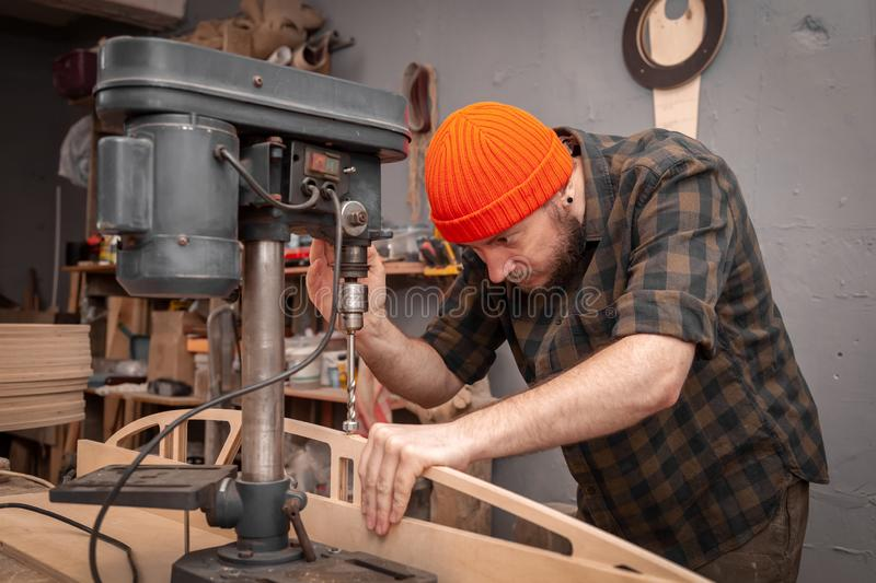Construction Worker. Using Drill To wood. Drill machine on the table in renovation work at home. Home repair concepts, close up royalty free stock images