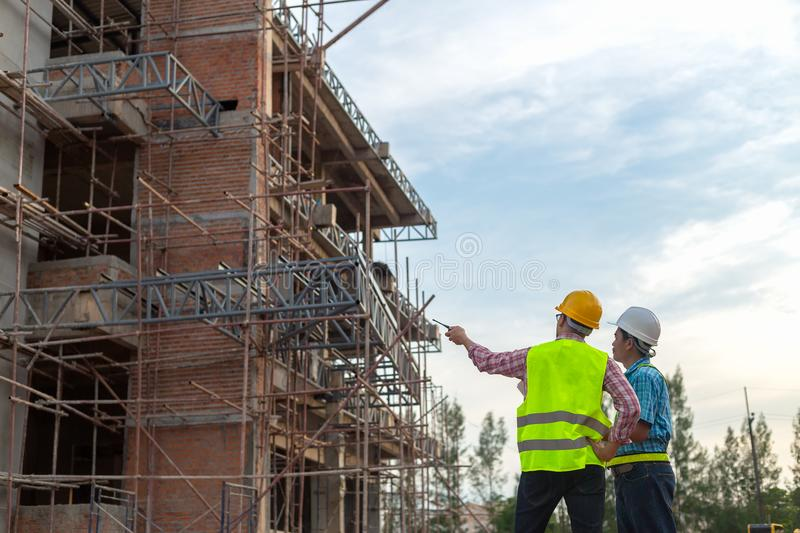 A construction worker control a pouring concrete pump on construction site. royalty free stock photos