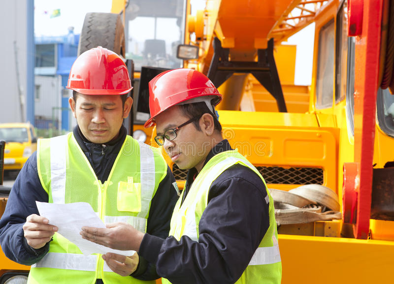 Construction worker and crane truck royalty free stock images