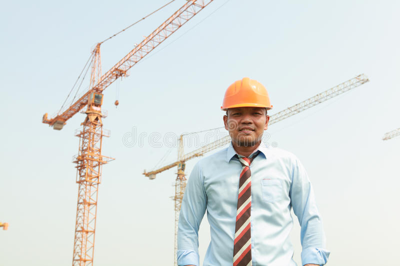 Construction worker and cranes royalty free stock photography